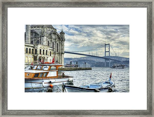 A Beautiful View Of Ortakoy Mosque And Framed Print by Senai Aksoy