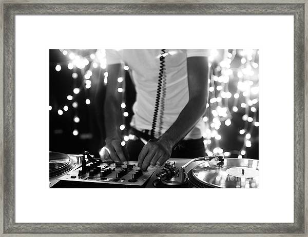 A Cool Male Dj On The Turntables Framed Print