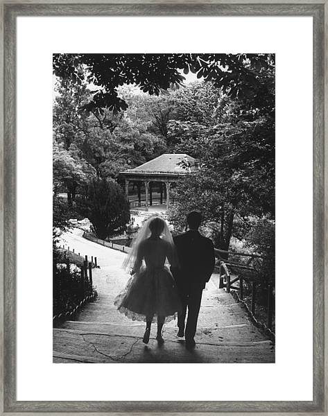 A Couple Just Married Taking A Walk In A Framed Print