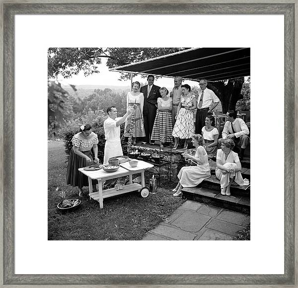 A Gathering Of Well Dressed Guests At A Framed Print