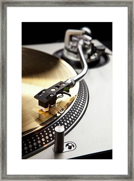 A Gold Record On A Turntable Framed Print