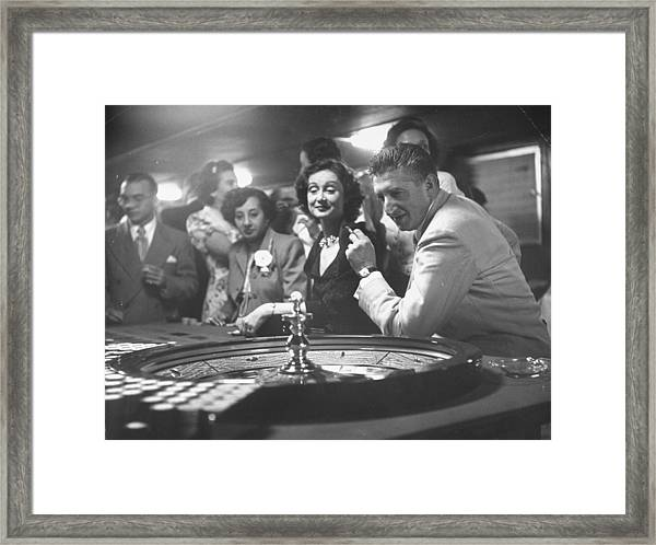 A Group Of People Gambling At A Roulette Framed Print by Gordon Parks