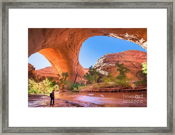 A Hiker At Jacob Hamblin Arch In Coyote Framed Print