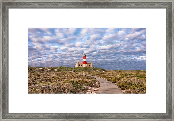 A Light On A Hill Framed Print