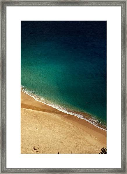 A Lone Sunbather Stretches Out On The Framed Print