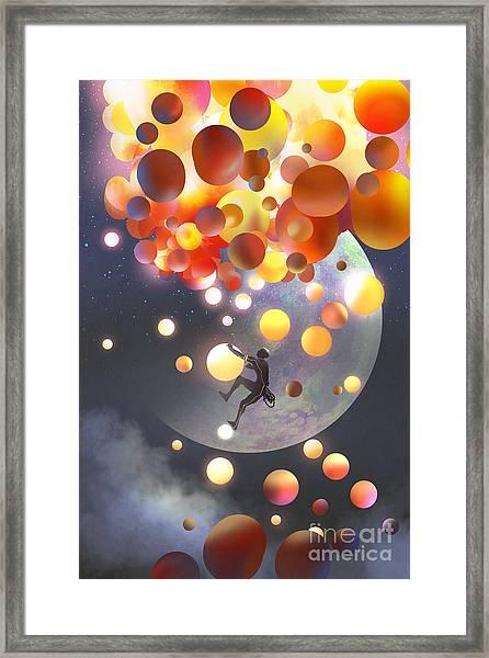 A Man Climbing Fantasy Balloons Against Framed Print