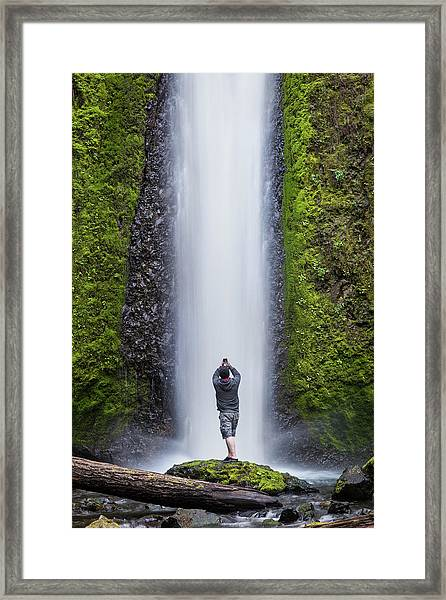 Framed Print featuring the photograph A Man Photographing A Waterfall by Nicole Young