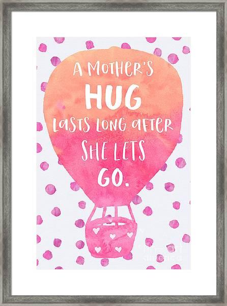 A Mother's Hug Framed Print