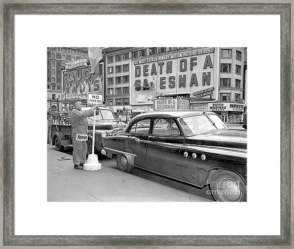 A No Parking Sign Is Posted At Framed Print