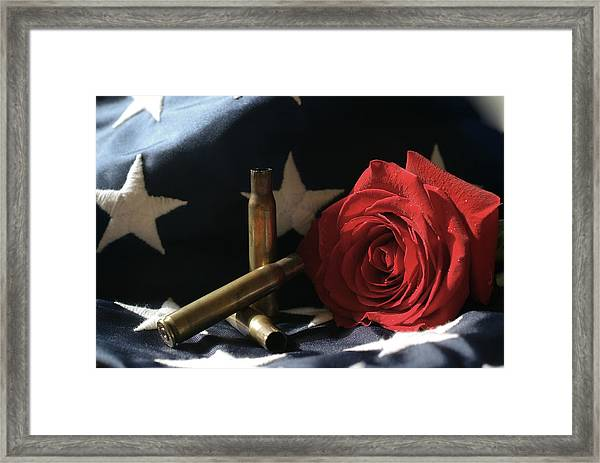 A Patriots Passing Framed Print