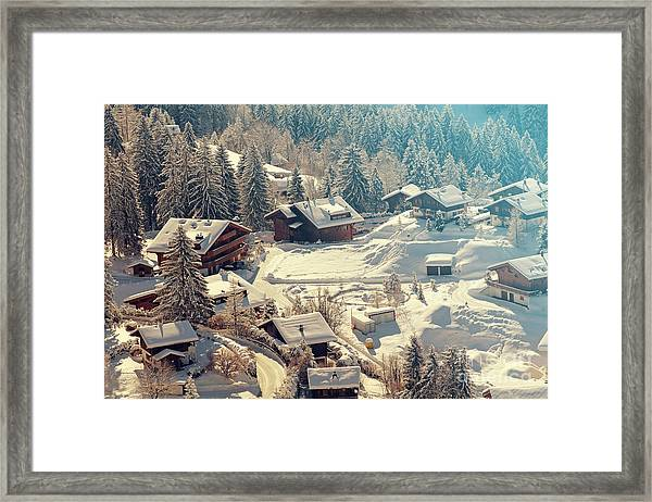 A Quaint Village In The Swiss Alps Framed Print by Saphotog