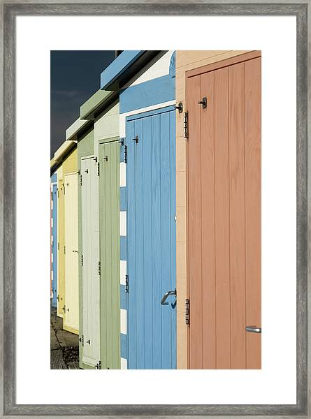 A Row Of Beach Huts Framed Print