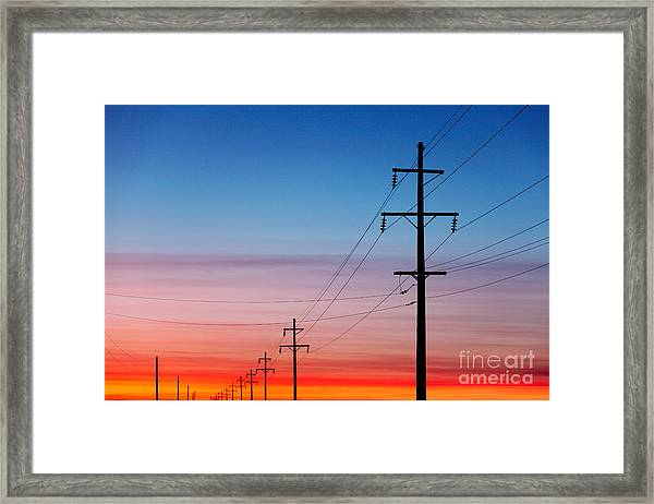 A Silhouette Of High Voltage Power Framed Print