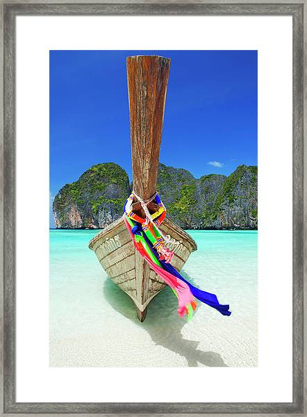 A Thai Longtail Boat Moored On The Framed Print