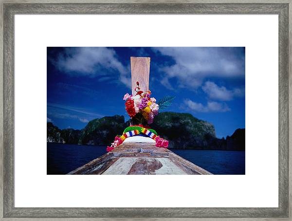 A Traditionally Adorned Longboat Framed Print