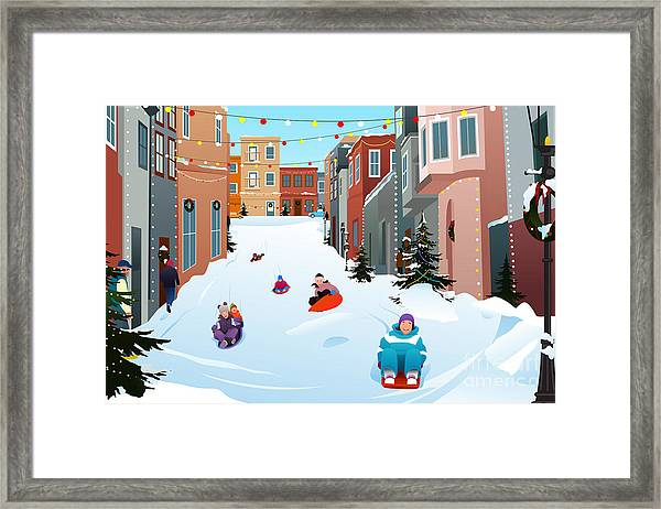 A Vector Illustration Of Kids Sledding Framed Print