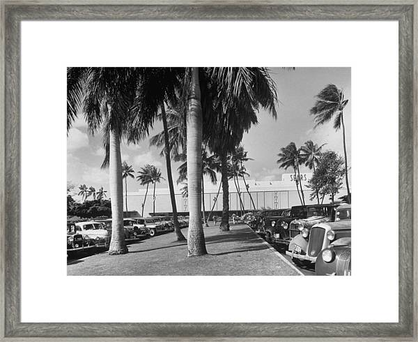 A View Through The Parking Lot Of A Sear Framed Print