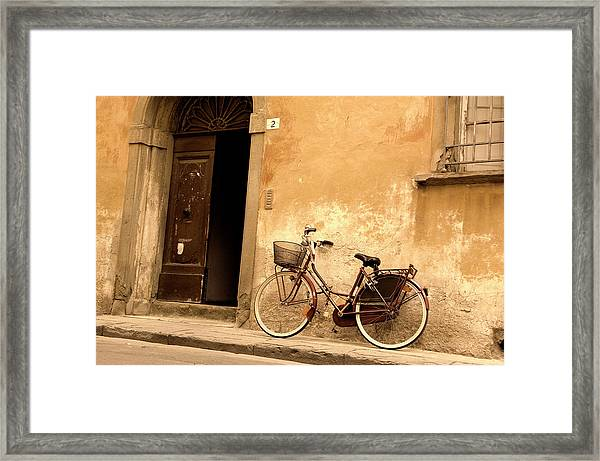 A Vintage Bicycle Leaning Against An Framed Print