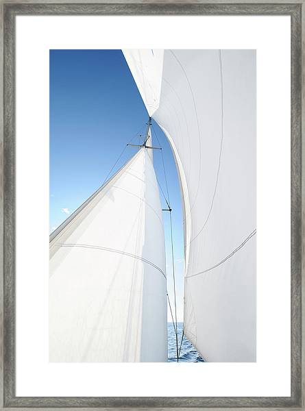 A White Sail Being Blown By The Wind Framed Print