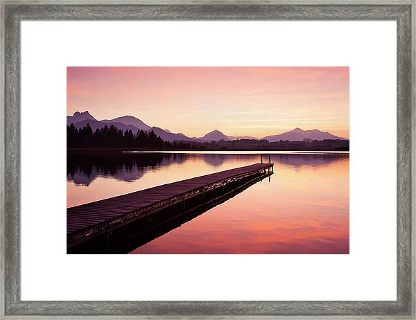 A Wooden Jetty On Lake Hopfensee After Framed Print