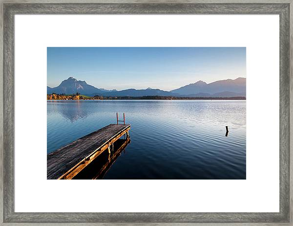 A Wooden Jetty On Lake Hopfensee At Framed Print