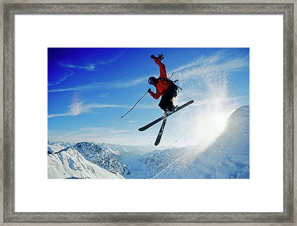 A Young Skier, A Freerider Jumping Over Framed Print