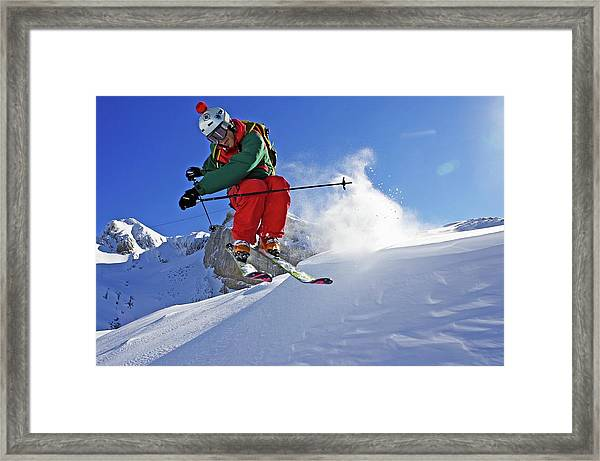 A Young Skier, A Freerider Jumps Over A Framed Print