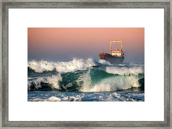 Abandoned Ship And The Stormy Waves Framed Print