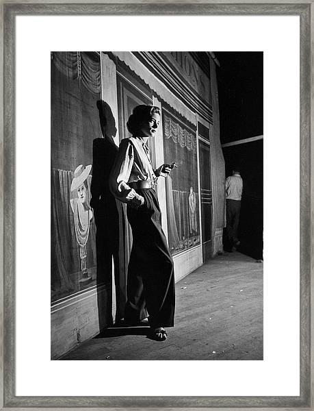 Actress Lauren Bacall Smoking A Framed Print