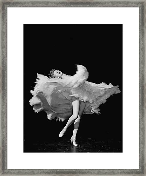 Actress Lucille Ball Dancing In Scene Framed Print by John Florea