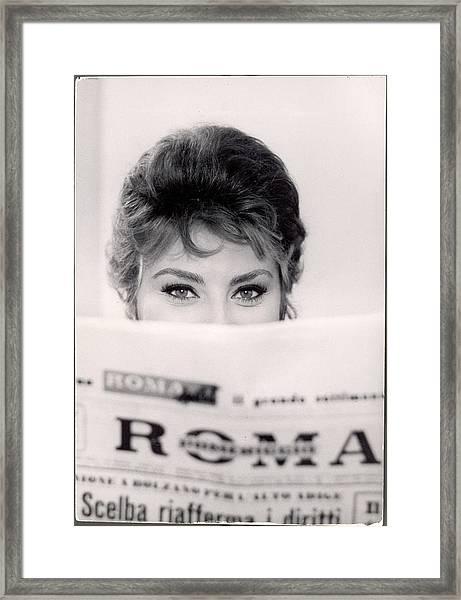 Actress Sophia Loren Impishly Peering Framed Print