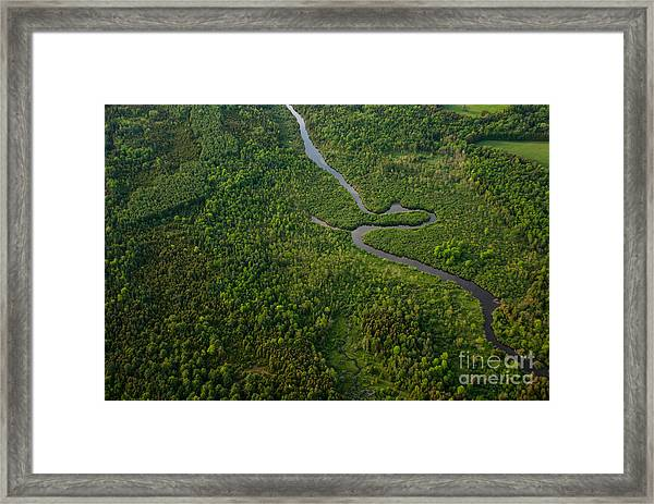 Aerial View Of A Winding River Framed Print