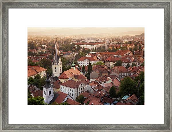 Aerial View Of Church And Rooftops Framed Print by Cultura Rf/lost Horizon Images