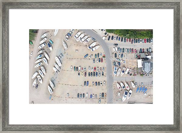 Aerial View Of Dock And Parking Lot Framed Print by Floresco Productions