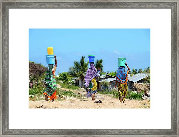 African Women Go To Fetch Water W Framed Print by Volanthevist