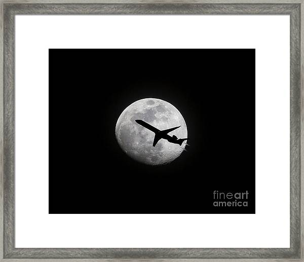 Airliner Passing In Front Of A Full Moon Framed Print