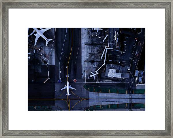 Airliners At Gates And Control Tower At Framed Print