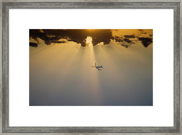 Airpline In Flight At Sunset Framed Print