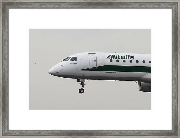 Alitalia Embraer 190 And Bird  Framed Print