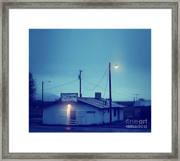 An Old Run Down Cafe During A Storm Framed Print