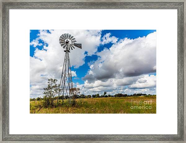 An Old Vintage Windmill Used To Pump Framed Print