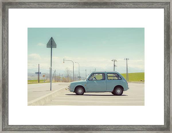Aqua Color Car In Parking Lot Framed Print