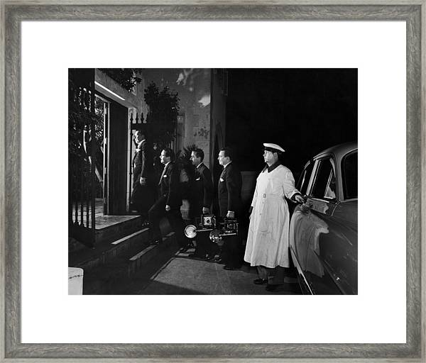 Arriving With His Own Photographers Framed Print