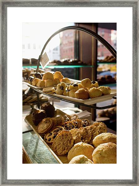 Assorted Pastries On Display In A Cafe Framed Print