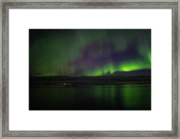 Aurora Borealis Reflecting At The Sea Surface Framed Print