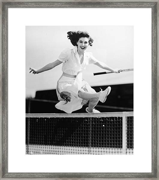 Ava Gardner Jumps Net On Tennis Court Framed Print