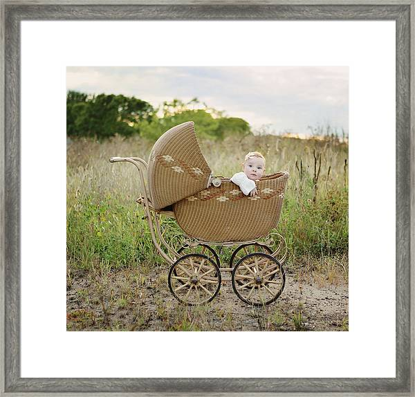 Baby Girl In Baby Buggy Framed Print