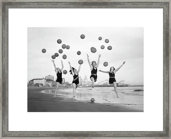 Balloon Dancers On Long Beach Framed Print by Bettmann