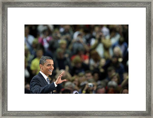 Barack Obama Campaigns In Golden Framed Print by John Moore