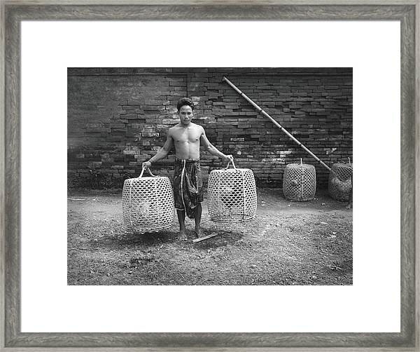 Bare-chested Balinese Man Holding Two Framed Print